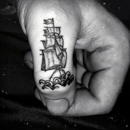 Finger Tattoo Of Sailboat For Men In Black Ink