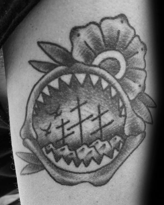 Guy With Shaded Ship And Shark Jaw Old School Thigh Tattoo
