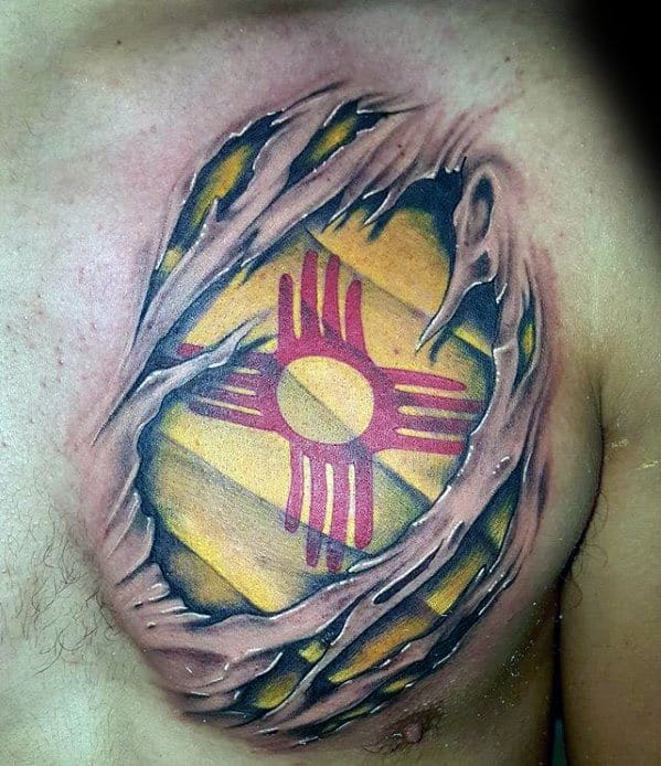 Guy With Zia Tattoo Design Ripped Skin Flag Chest