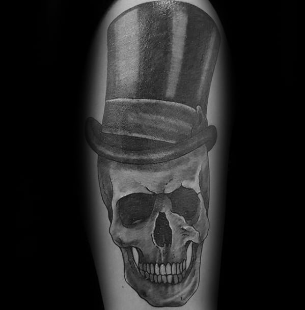 Heavily Shaded Black And Grey Arm Skull With Top Hat Mens Tattoo Ideas