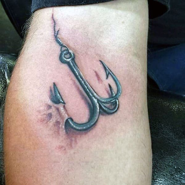 Mens Fish Hook Catching Skin Tattoo On Arm