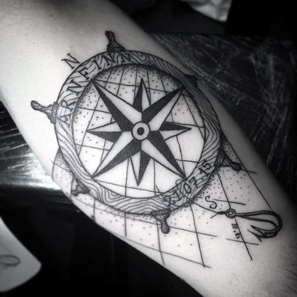 Ship Steering Wheel With Nautical Star And Simple Fish Hook Tattoo For Men On Inner Forearm