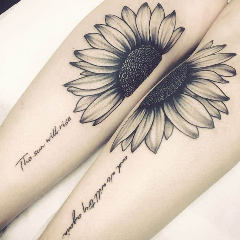 large black and grey tattoos on two women's forearms of half a sunflower matching up together on each arm