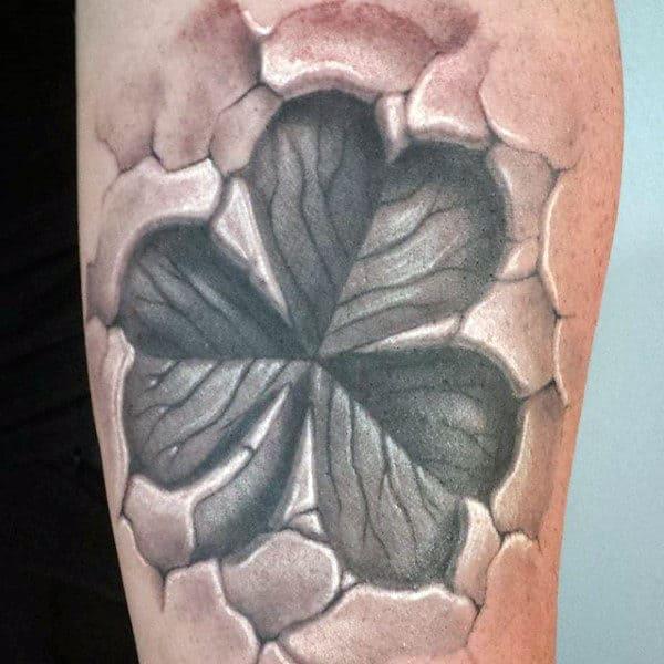 3d Broken Skin Tattoo Four Leaf Clover On Man