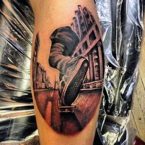 3d Man Riding Skateboard Tattoo On Leg Calf