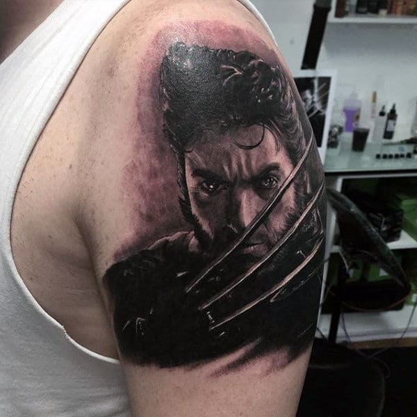 3d Realistic Wolverine Tattoo With Hames Howlett On Mans Upper Arm