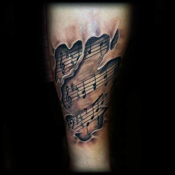 3d Ripped Skin Music Staff Tattoo Design On Mans Forearm