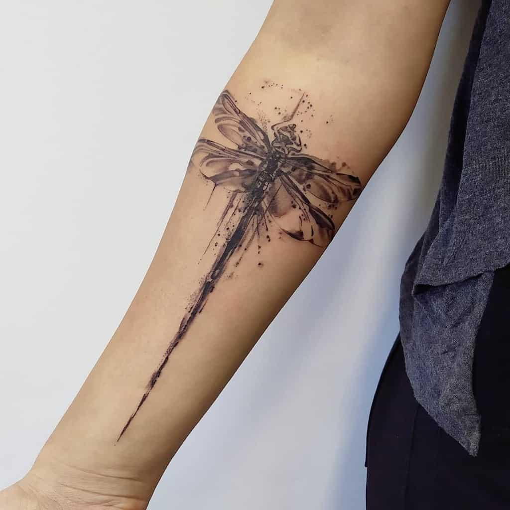 The magnificent dragonfly covering the arm resonating nothing but surreal image