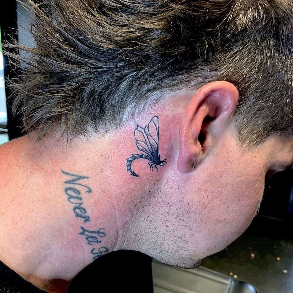 A flawless dragonfly inked behind the ear to accenturate that perfect hair line