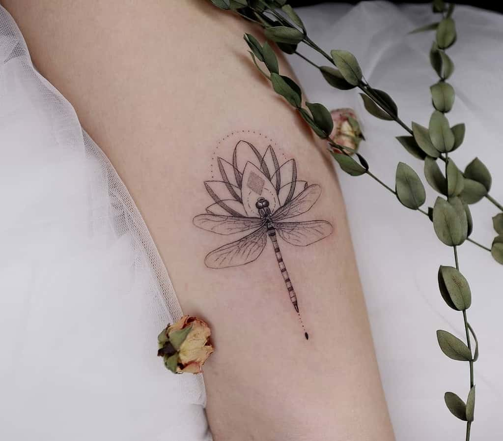 The dragonfly infused in the petals showing the bloom and evolving into something better