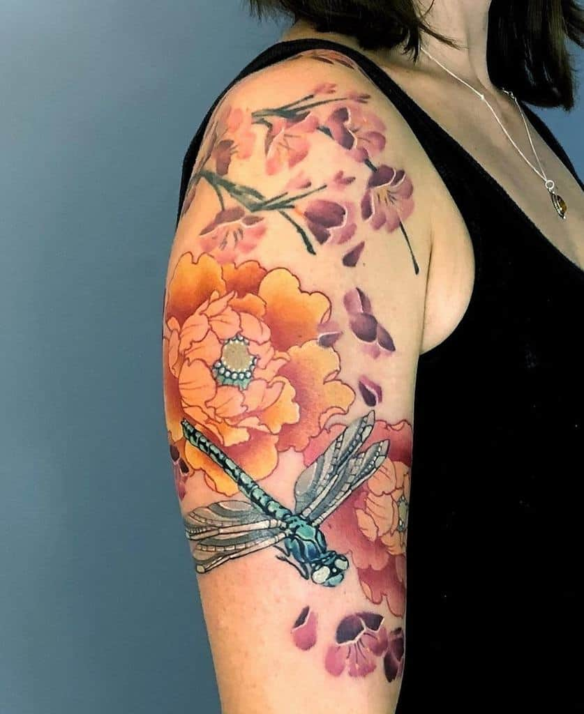 The dragonfly flying around with the flowers accentuating the colors of life and poses the liveliness