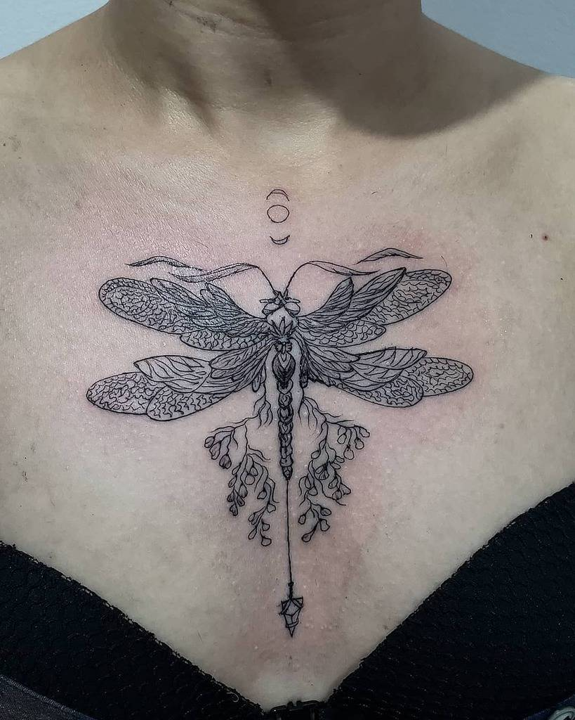 The intricated dragonfly just below the jurgul posing a perfect gothic look