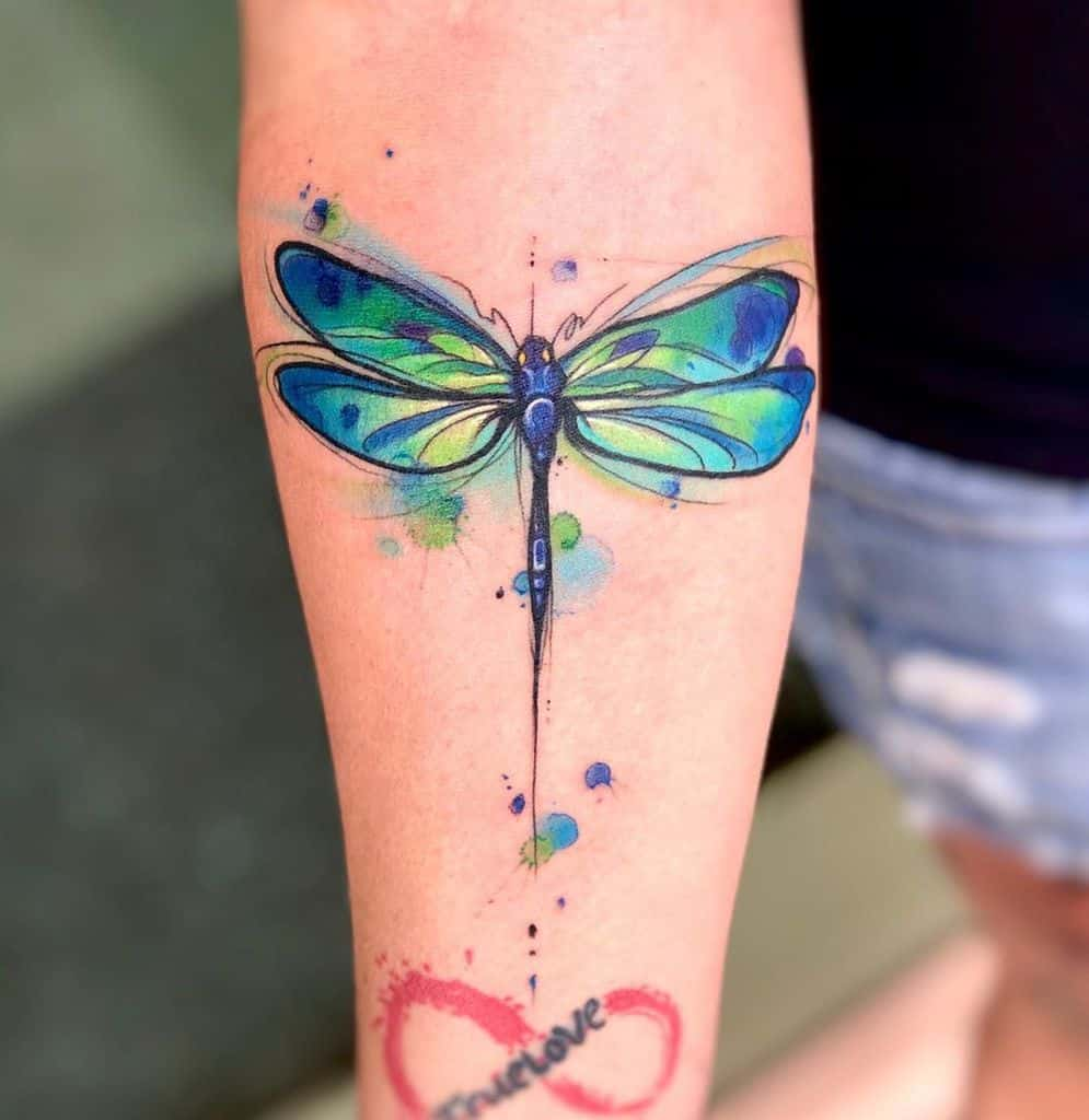 The striking blue dragonfly raving out harmony in full glory topped with the love accents