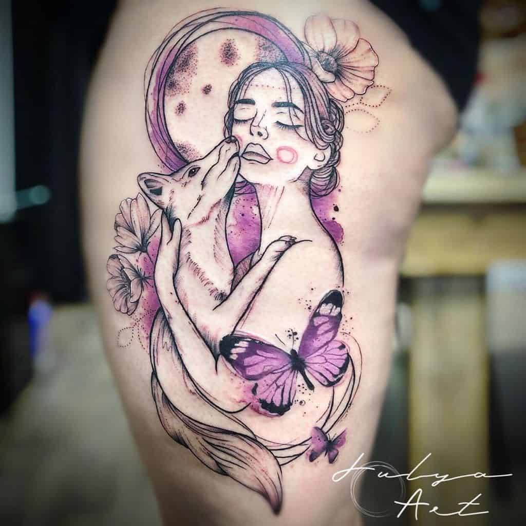 large color watercolor tattoo on woman's thigh of a surrealistic girl holding a dog with flowers and butterflies around her