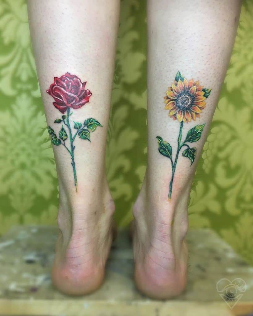 medium-sized color tattoo on back of woman's lower leg of a realistic sunflower with stem