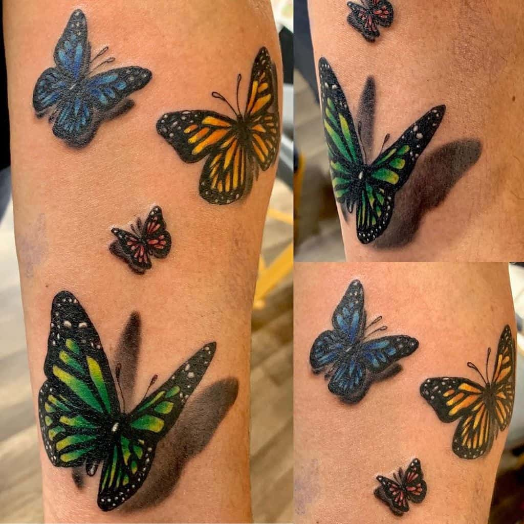 large color tattoos on a woman's lower leg of multiple realistic butterflies with shadows