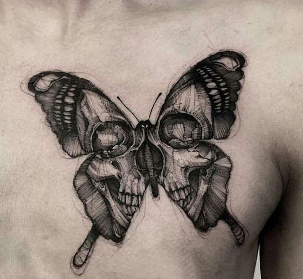 large black and grey traditional tattoo on man's chest of a surrealistic butterfly with skull face in its wings