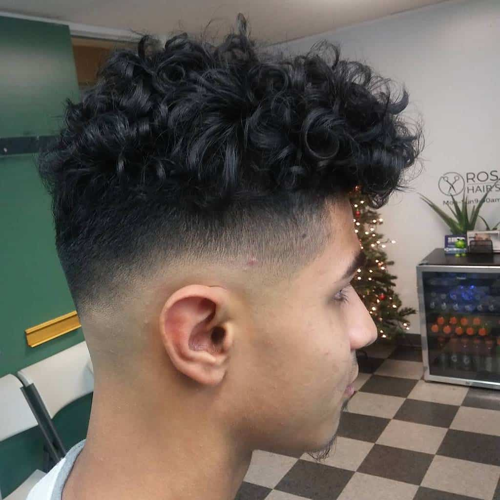 A Jewfro Hairstyle With A High Fade And A Side Burn