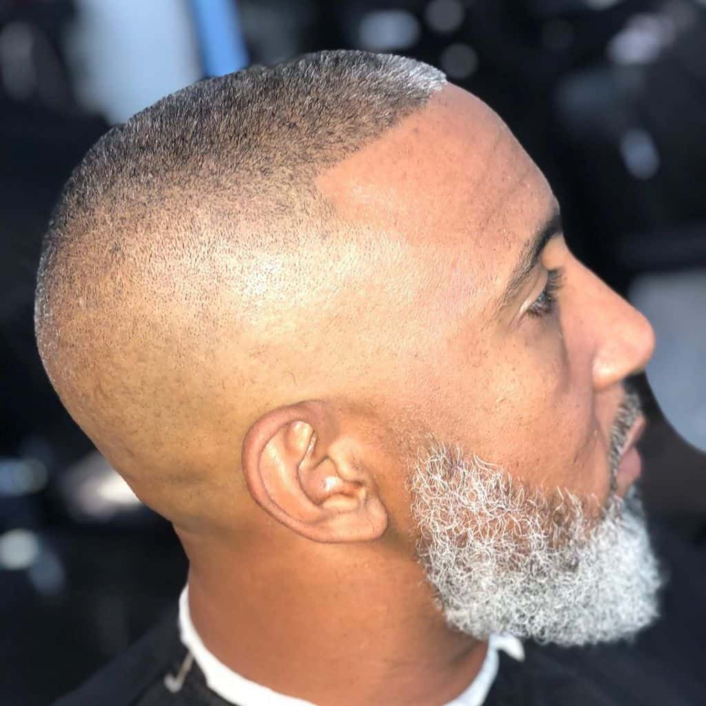 A Bossy Hi Top Fade Featuring Long Flat Hair On Top With Gray Highlights