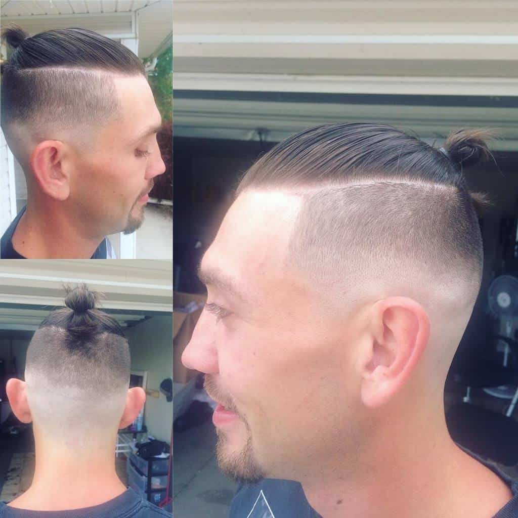 A Classic Man Bun Style Paired With A High Fade