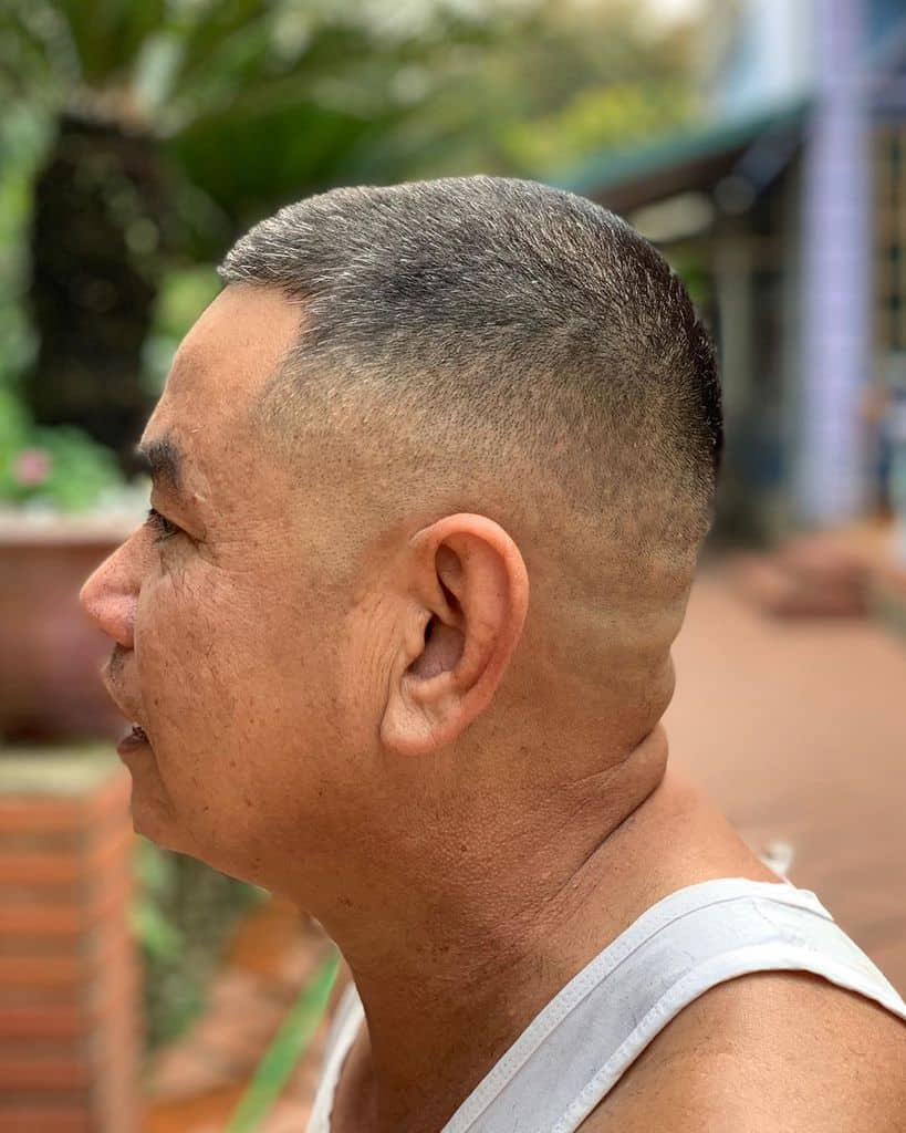 A Haircut For Older Guys Featuring Long Hair On Top And Faded Sides