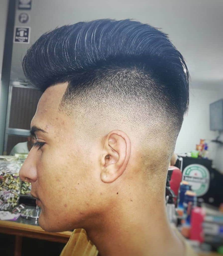 A Hi Top Cut Paired With A Disconnected Undercut And Sharp Fade
