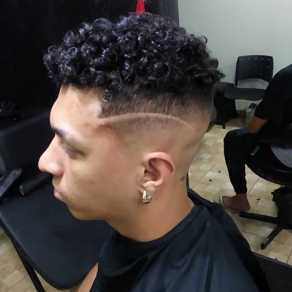 A Man Wearing High Top Skin Fade Where The Hair On The Sides And Back Fades Into The Skin