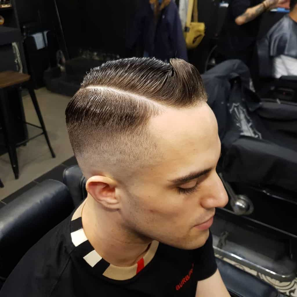 A Men's Hairstyle With Quiff Cut Paired With Taper Fade