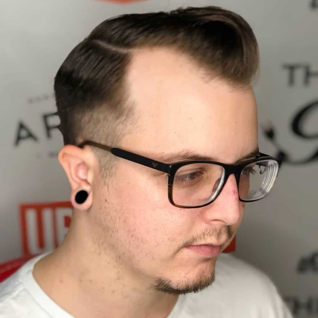 A Regulation Cut Featuring Long Manes On Top And Tapered Sides And Back