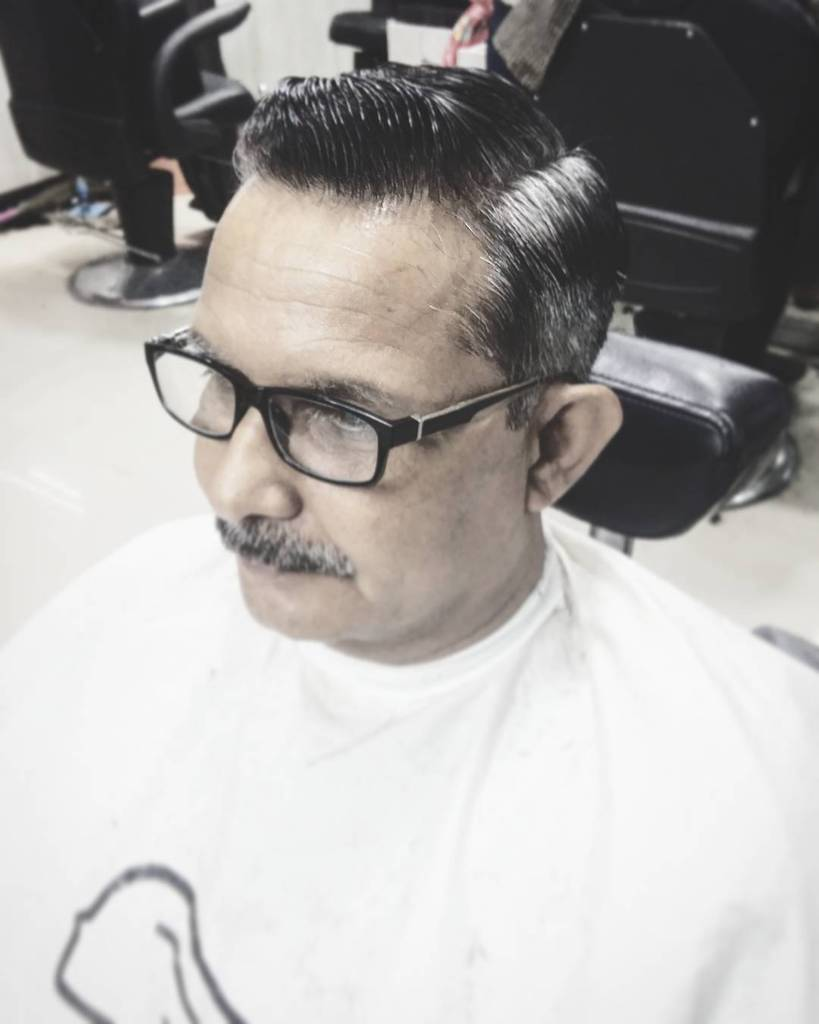 A Side Parted Cut For Older Men Matched With A Comb Over For Stylish Look