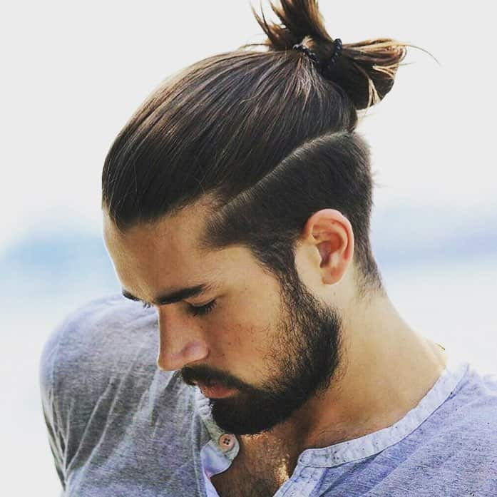 A Slick And Polished Man Bun Undercut Style For Professionals