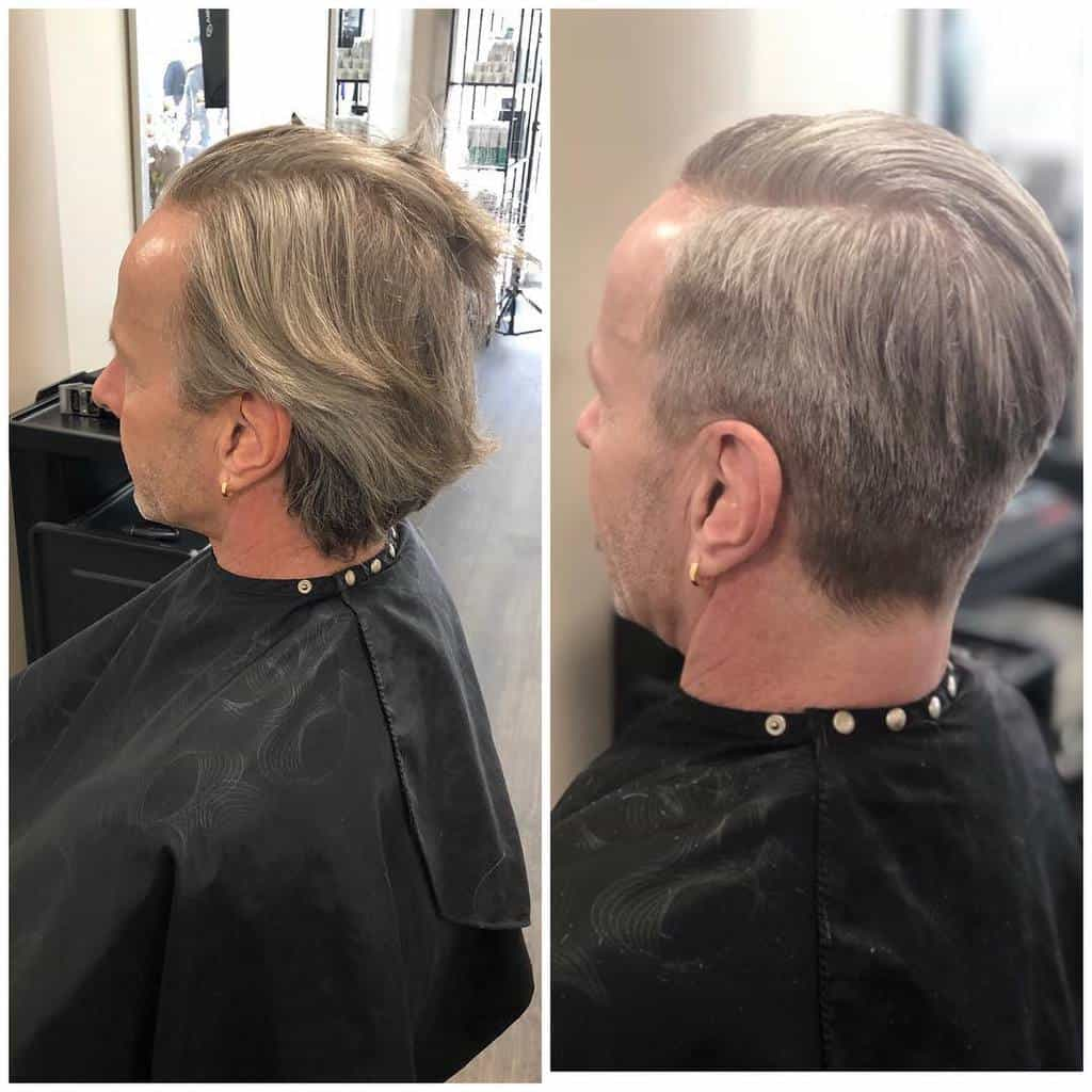 A Slicked Back Haircut For Older Folks. The Cut Is Matched With An Undercut