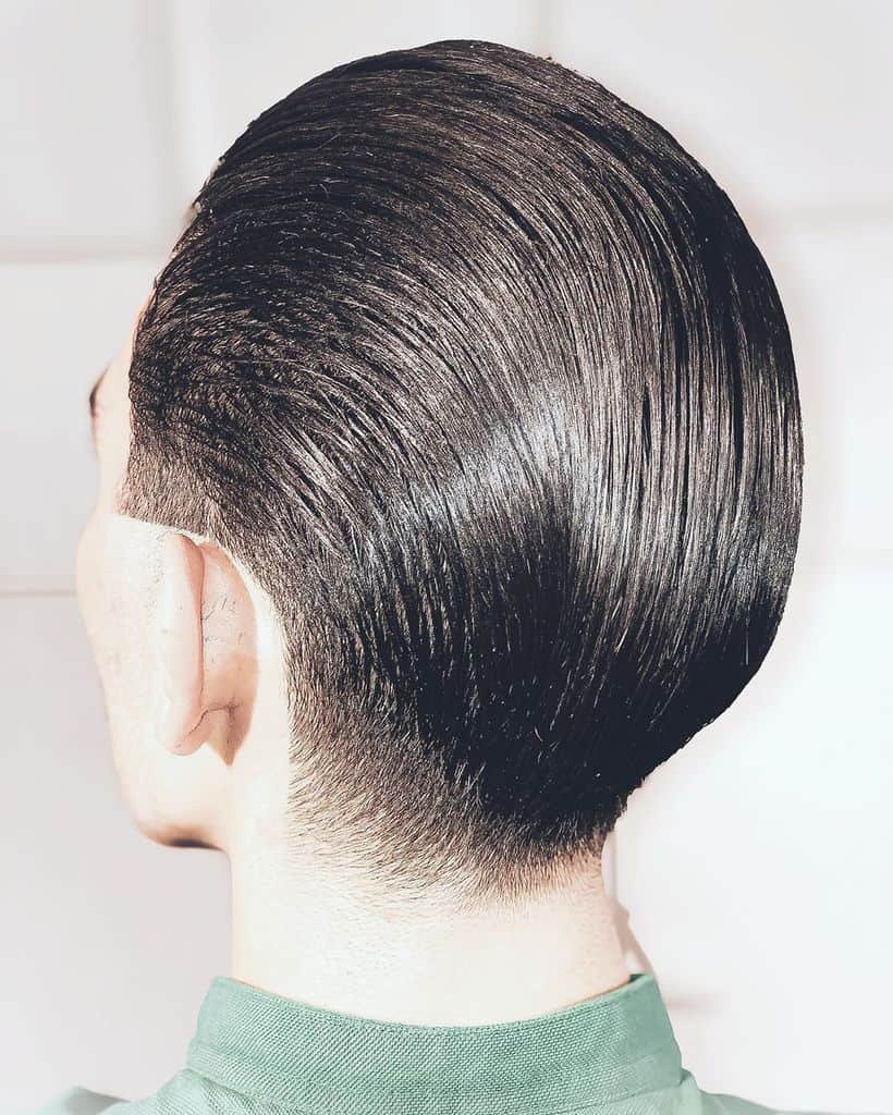 A Slicked Back Pompadour Hairstyle Shown From The Back
