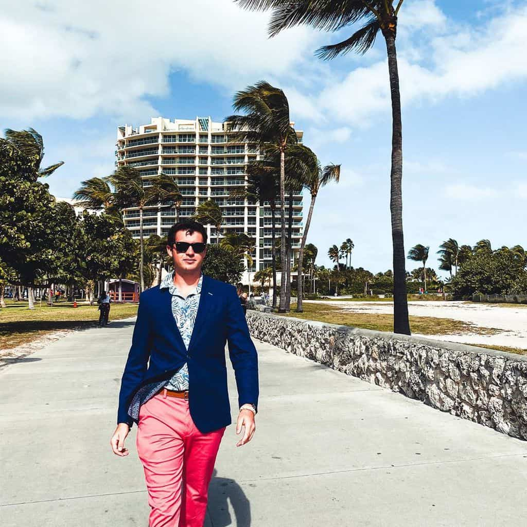 A Stylish Man Wearing Nantucket Reds (faded Chinos) And A Classic Navy Blue Blazer