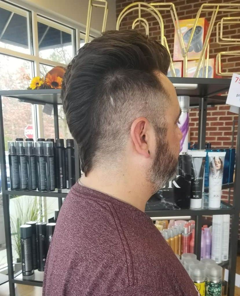 A Typical Faux Hawk Cut With Faded Sides And Slightly Longer And Spiked Hair On Top