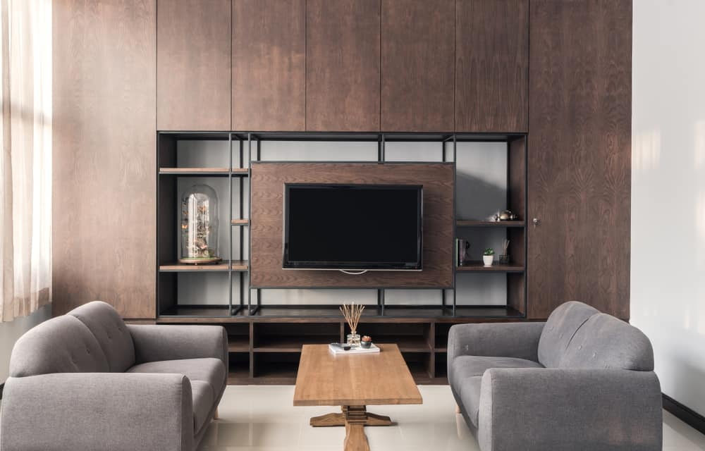 Living,Room,Interior,In,Gray,Sofa,And,Brown,Wood,Furniture