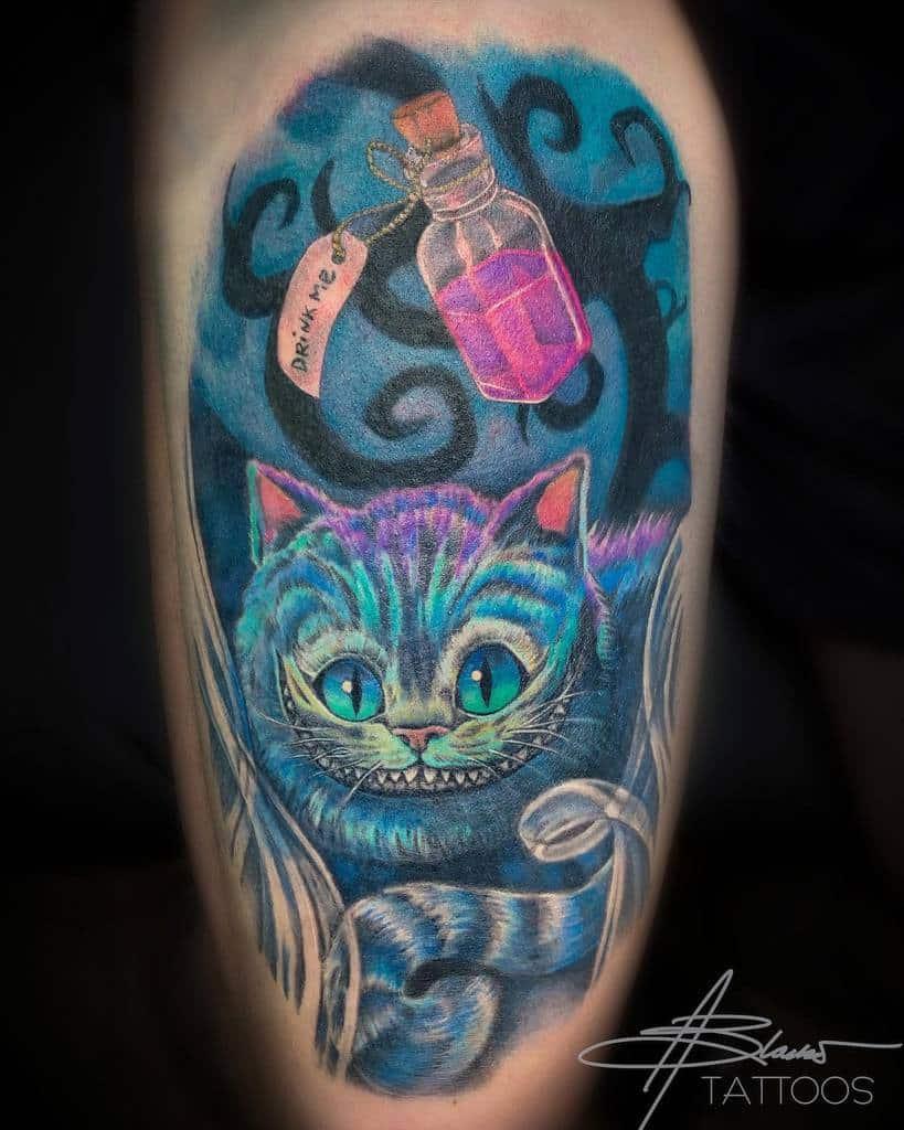 Alice in Wonderland Cheshire Cat Tattoo ablaskotattoos