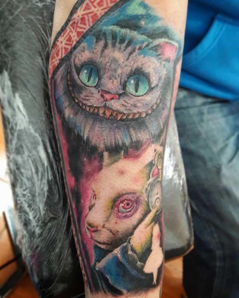 Alice in Wonderland Cheshire Cat Tattoo daggers_tattoo1