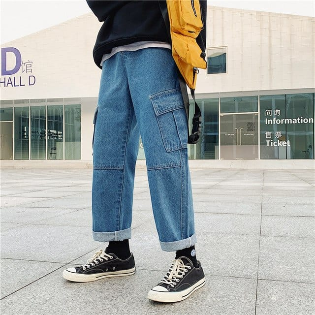 Cuffing baggy jeans is a great way to bring more dimension to an outfit