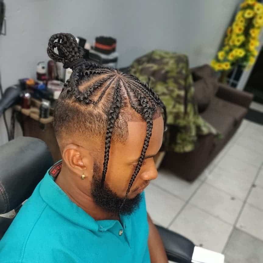 Beautiful Cornrows Styled On Top Of The Head And Paired With An Undercut And Braid Bangs