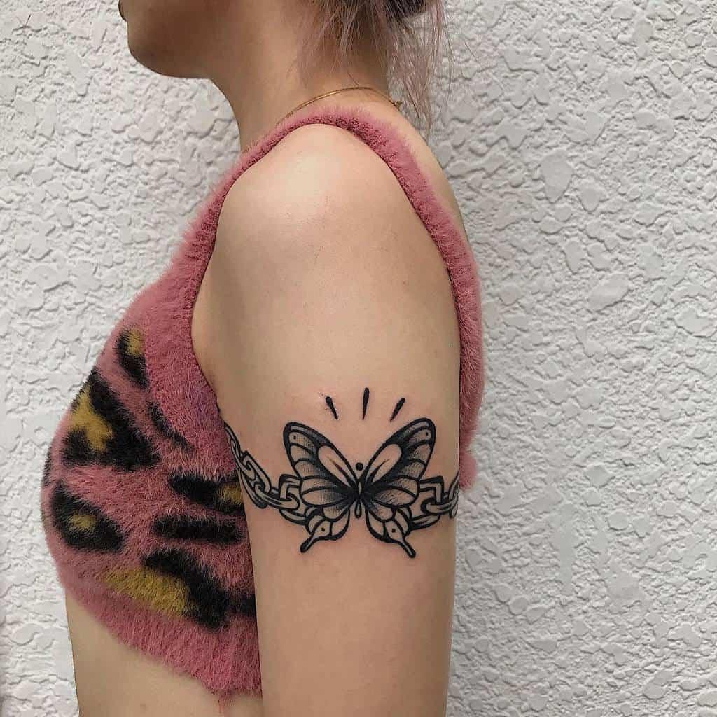 Black Butterfly Upperarm Tattoo peanuttattoo