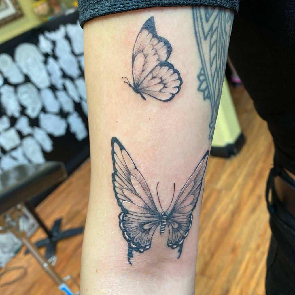 Black Butterfly Upperarm Tattoo reyestatts