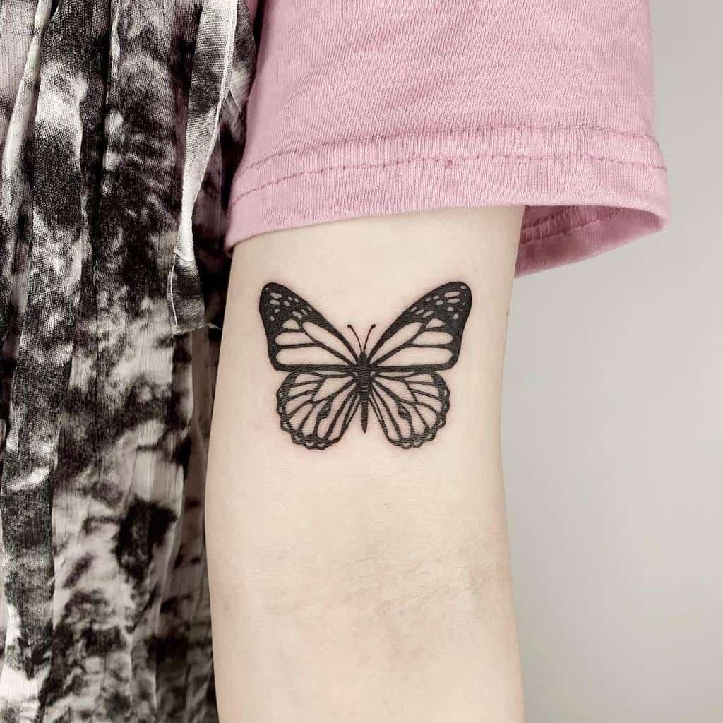 Black Butterfly Upperarm Tattoo rudo_tattoo