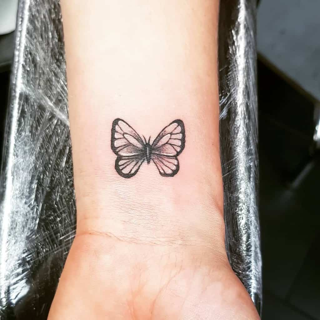 Black Butterfly Wrist Tattoo jorremarek