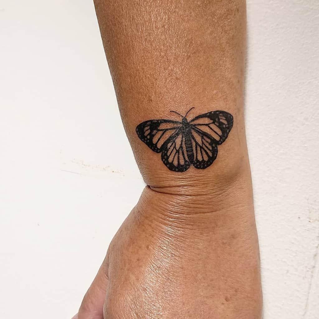 Black Butterfly Wrist Tattoo shredderina.ink