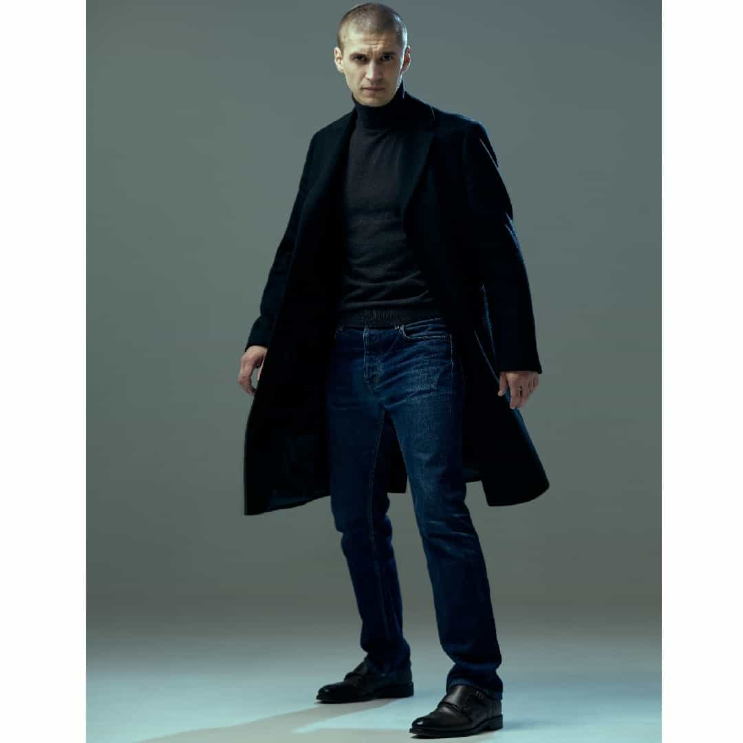 Angry,Looking,Man,In,Black,Coat,On,Gray,Studio,Background.
