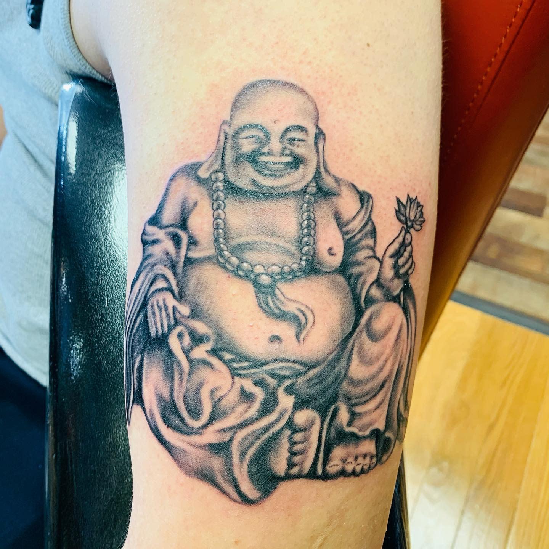 Laughing Buddha Tattoo -conquesttattoostudio