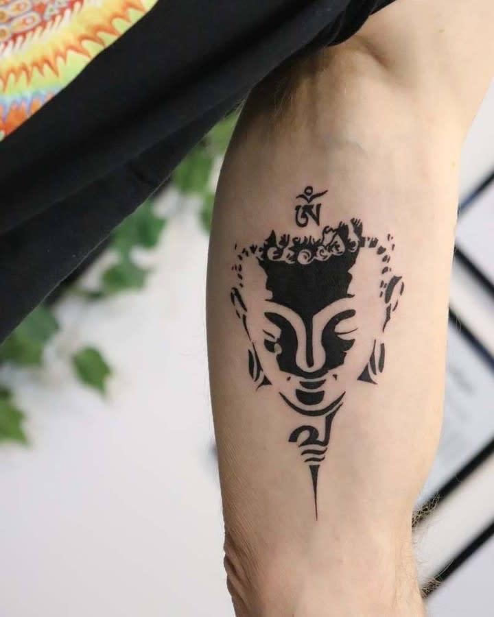 Small Buddha Tattoo -lotus_tattoo_piercing