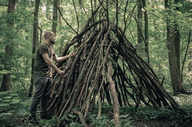 Building-a-shelter-How-To-Survive-In-The-Woods