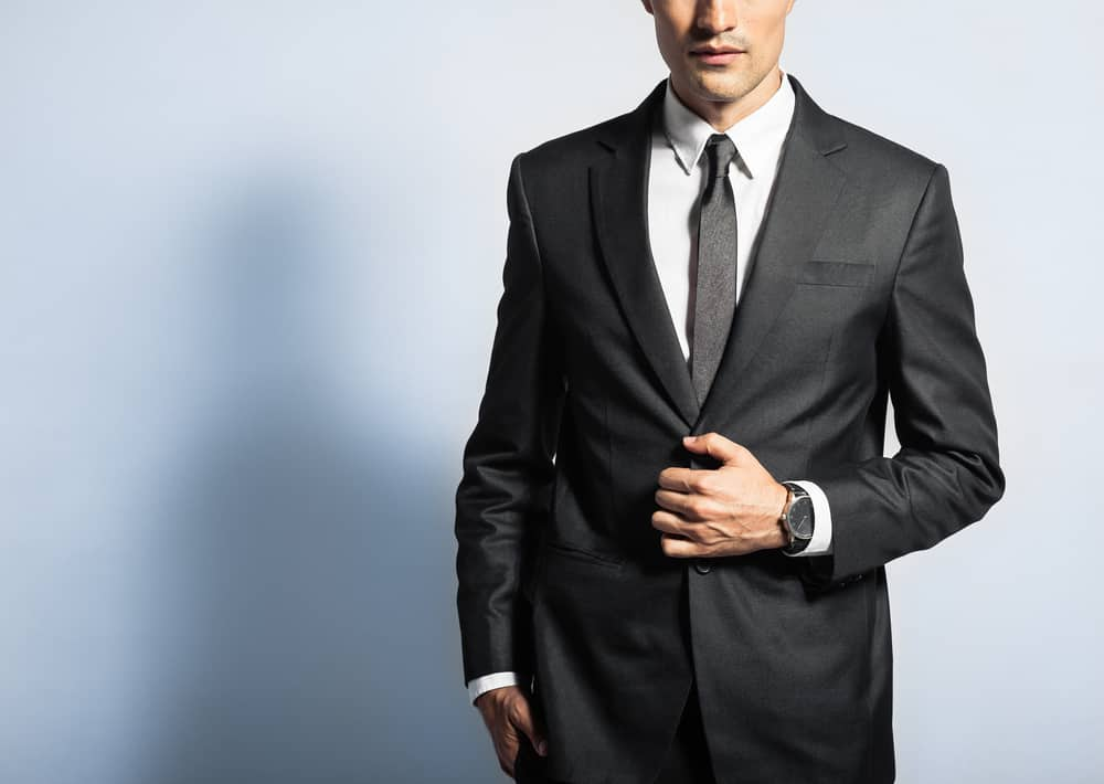 A black suit with a white button-down shirt and a dark colored tie is traditional, but this isn't required. Charcoal, dark gray, and navy suits are good options, as well.